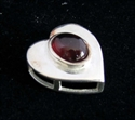 Picture of 21 x STERLING SILVER HEART PENDANTS WITH OVAL SHAPED GARNET CABOCHON WHOLESALE-LOT