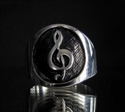 Picture of 21 x ROUND STERLING SILVER RINGS WITH A CLEF MUSICIAN SYMBOL WHOLESALE-LOT